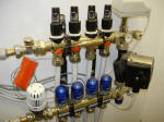A fully configured underfloor heating manifold with 4 zones